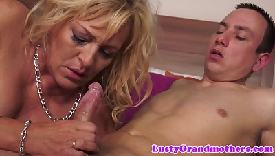 Busty grandma seduced by a younger lover