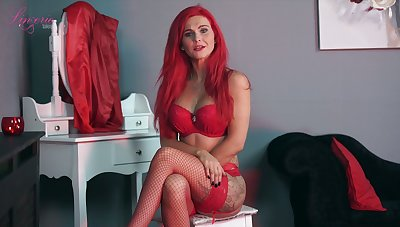 Sexually charged red haired main Roxi K tells erotic stories in sexy underclothing