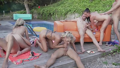 Outdoor orgy apart from the pool be required of the needy wives addicted to cock
