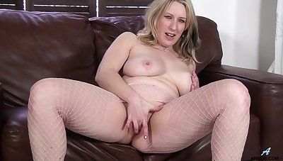 Mel Harper enjoys pleasuring her cravings in excess of a leather couch